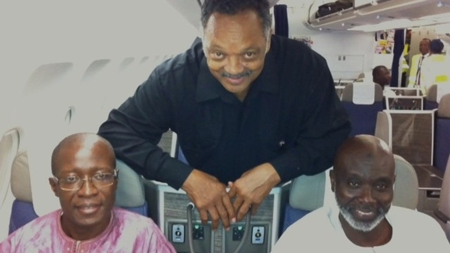 Sept. 18, 2012: The Rev. Jesse Jackson with Amadou Janneh and Tamsir Jasseh on the flight to the U.S.