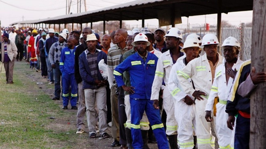 Sept. 20, 2012: Miners return to work at the Lonmin Platinum mine after Lonmin resolved a five-week strike by agreeing to pay raises of up to 22 percent, in Marikana, Rustenburg, South Africa.
