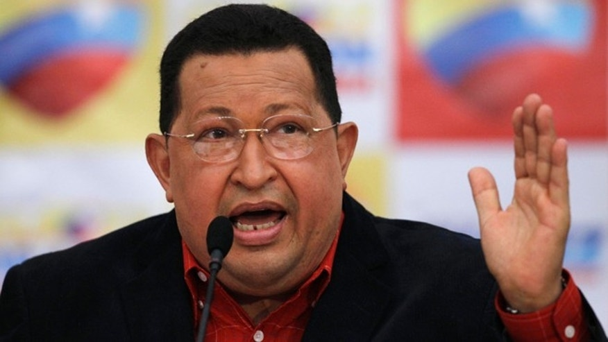 Venezuela's president Hugo Chavez speaks during a news conference, his first as presidential candidate of the United Socialist Party of Venezuela for the upcoming elections, in Caracas, Venezuela, Monday, July 9, 2012. Venezuelans will go to the polls October 7. (AP Photo/Ariana Cubillos)