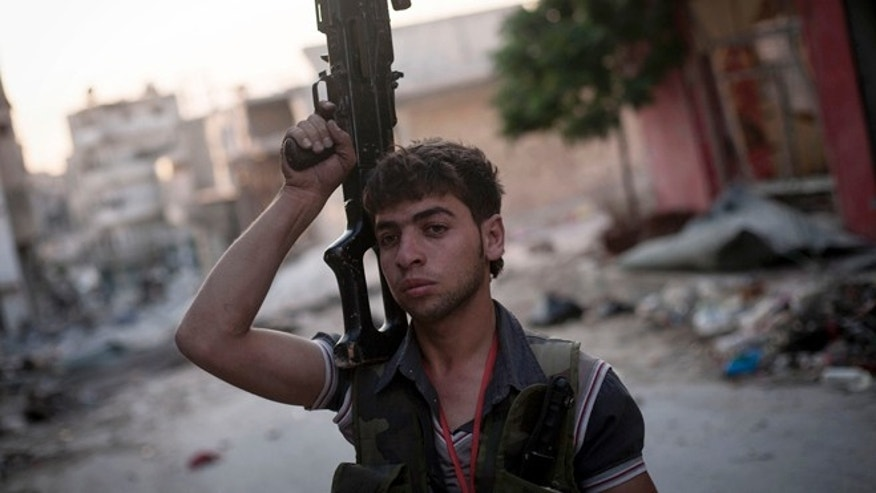 Sept. 19, 2012: A Free Syrian Army fighter soldier stands at the front line in the Amariya district in Aleppo, Syria.