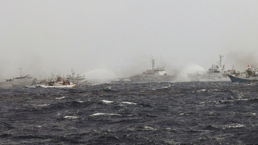Sept. 25, 2012: In this photo released by Taiwan's Central News Agency, Japan Coast Guard patrol boats spray their water cannons towards a Taiwan Coast Guard patrol boat and Taiwanese fishing boats near the disputed islands called Senkaku in Japan and Diaoyu in China, in the East China Sea.