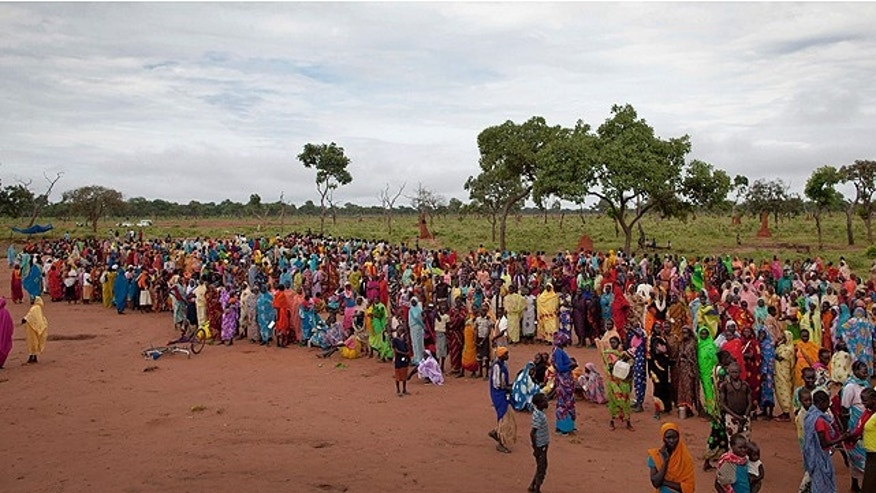 Sept. 15, 2012: Refugees wait in line to receive packages of food that had been air-dropped by the World Food Programme (WFP) the previous day, in Yida camp, South Sudan.