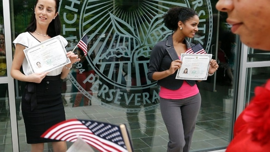 Massachusetts has the seventh-largest population of legal immigrants in the country, with about 320,000 people holding green cards given to legal permanent U.S. residents in 2010. (AP Photo/Elise Amendola)