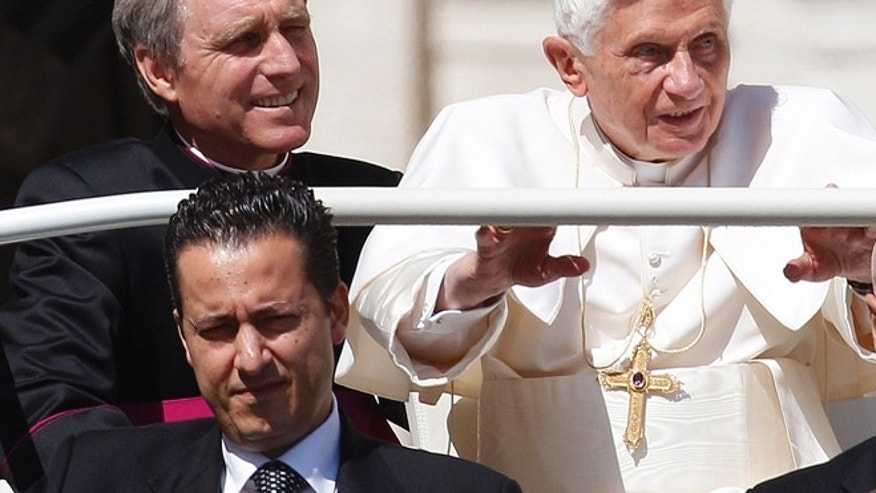 May 2, 2012: Pope Benedict XVI arrives in St. Peter's square at the Vatican for a general audience as his then-butler Paolo Gabriele, bottom, and his personal secretary Georg Gaenswein sit in the car with him.