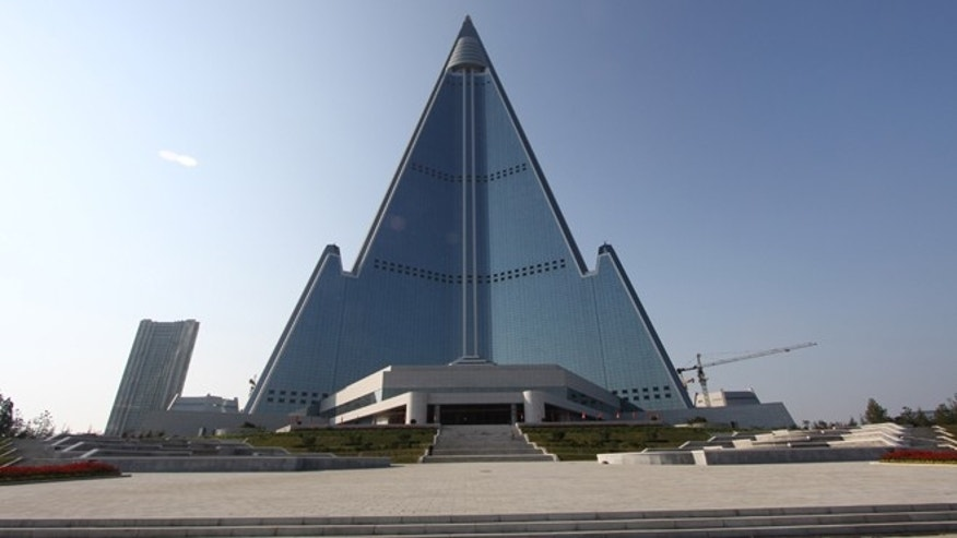 In this Sept. 23, 2012 photo released by Koryo Group on Wednesday, Sept. 26, 2012, the pyramid-shaped, 105-story Ryugyong Hotel stands in Pyongyang, North Korea.