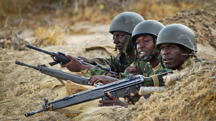 Feb. 20, 2012: File photo, Kenyan army soldiers stand in a dugout position at their base in Tabda, inside Somalia. Kenya's military said Friday, Sept. 28, 2012 that its troops attacked Kismayo, the last remaining port city held by Al Qaeda-linked al-Shabab insurgents in Somalia, during an overnight attack involving a beach landing.