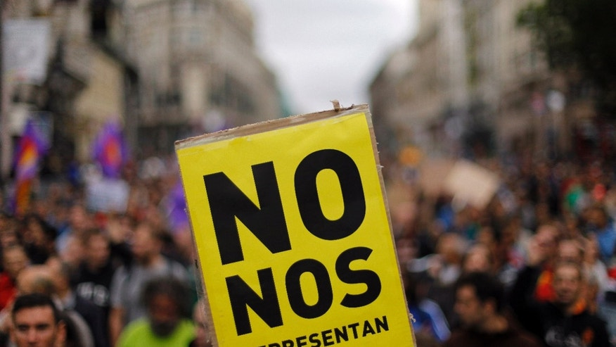 "Sept. 25, 2012: Protestors hold a banner reading ""you don't represent us""  during a demonstration  against austerity measures announced by the Spanish government in Madrid, Spain."