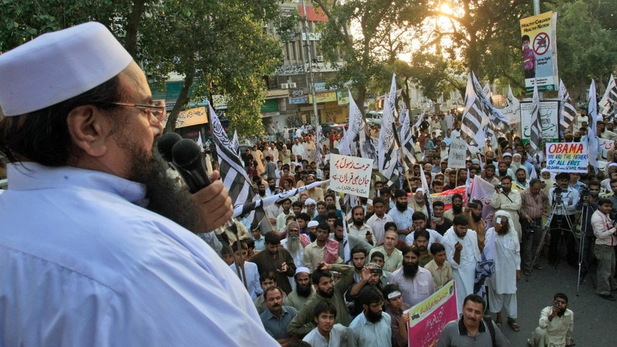 Sept. 30, 2012: Hafiz Saeed, leader of Pakistani religious group Jamaat-ud-Dawa, left, delivers a speech during a protest against a film insulting the Prophet Muhammad, in Lahore, Pakistan.