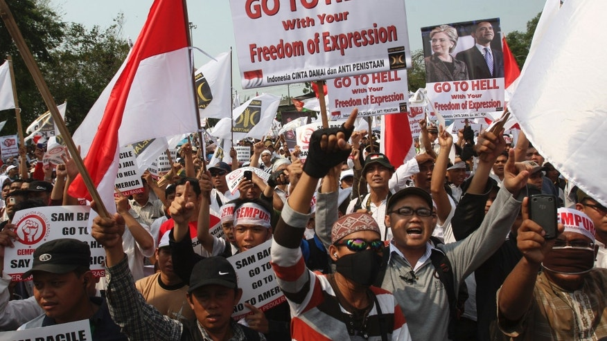 Sept. 30, 2012: Indonesian Muslims shout slogans during a protest against an anti-Islam film that has sparked anger among followers, outside the U.S. Embassy in Jakarta, Indonesia.