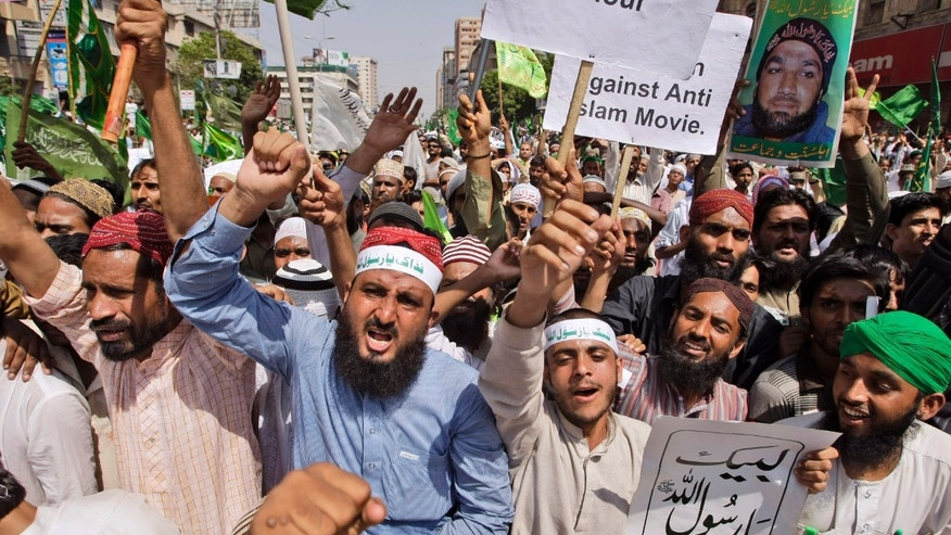 Sept. 29, 2012 - Pakistanis shout slogans during a rally to protest against a film insulting the Prophet Muhammad, in Karachi, Pakistan.