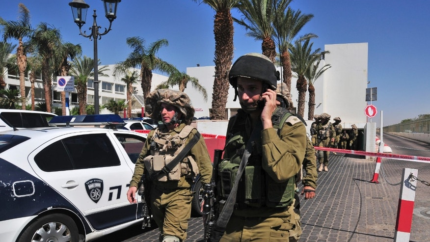 Israeli soldiers secure the area near the site of a shooting incident at a hotel in the Red Sea resort town of Eilat, Israel, Friday, Oct. 5, 2012. A young American opened fire in a hotel in Eilat Friday, killing one person before police shot him dead in an incident that appeared to be a personal dispute. (AP Photo/Eliraz Getah) ISRAEL OUT