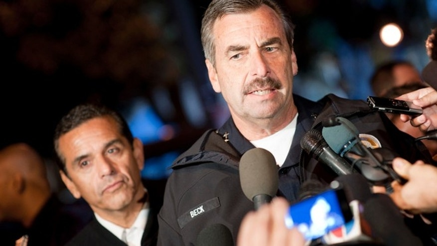 Los Angeles Police Department Chief Charlie Beck talks to members of the media. Behind him is Los Angeles Mayor Antonio Villaraigosa.