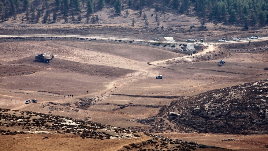 Oct. 6, 2012: Israeli Army vehicles and helicopters are seen in an open area as they search for the remains of a drone in the Negev southern Israel.