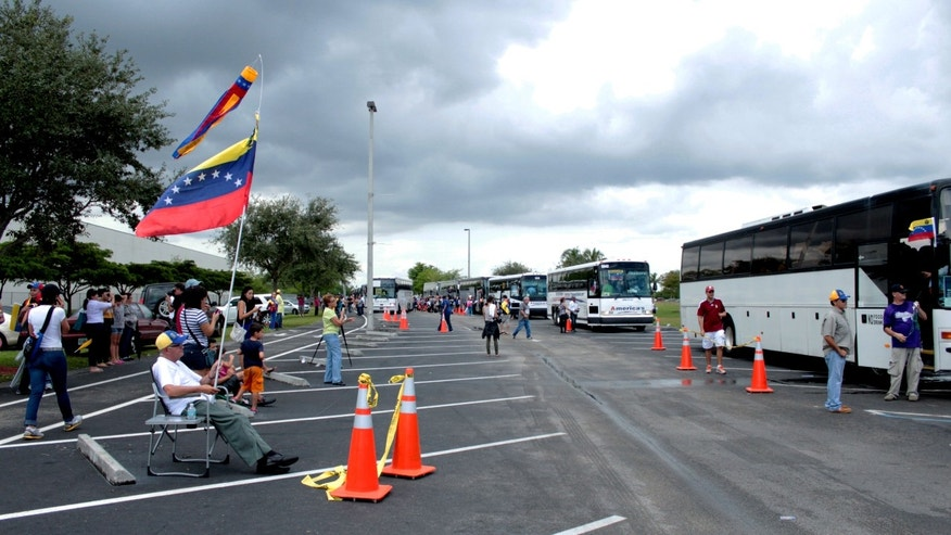 DORAL, FL- Buses depart for New Orleans, LA.