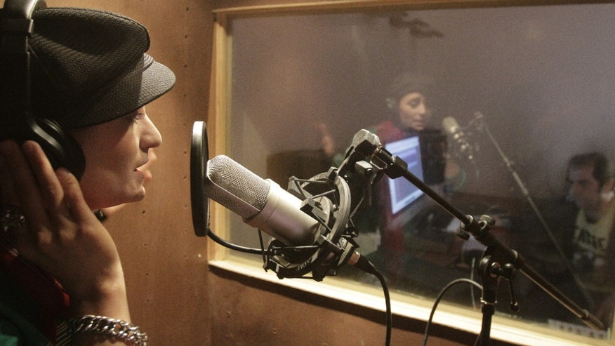Oct. 3, 2012: In this photo, Afghanistan's first female rapper Sosan Firooz sings in a studio in Kabul, Afghanistan. Firooz, 23-year-old singer is making history in her homeland where society frowns on women who take the stage.