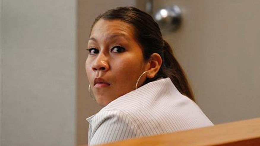 Elizabeth Escalona, 23, sits in a courtroom to be sentenced, in Dallas, Monday, Oct. 8, 2012.