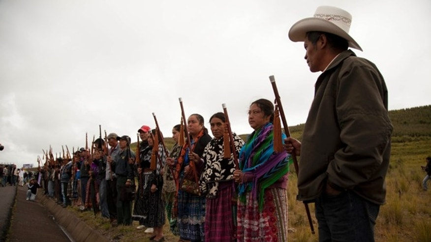 Community leaders from Totonicapan welcome human rights activists during a ceremony honoring Felix Sapon Yax at the site where he was killed in Santa Catarina Ixtahuacan, west of Guatemala City, Tuesday, Oct. 9, 2012. At least eight people were killed, among them Sapon Yax and some other 34 were injured when gunfire erupted Thursday, Oct. 4, during clashes between soldiers and demonstrators after a protest over electrical power prices and educational reform in an impoverished rural area west of the capital. (AP Photo/Moises Castillo)