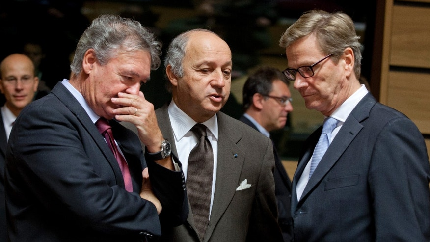 From left, Luxembourg's Foreign Minister Jean Asselborn, French Foreign Minister Laurent Fabius and German Foreign Minister Guido Westerwelle share a word during a meeting of EU Foreign Ministers in Luxembourg on Monday Oct. 15, 2012. Britain, Germany and France say they expect the European Union to approve even tougher sanctions on Iran to prevent it from developing nuclear weapons. (AP Photo/Virginia Mayo)