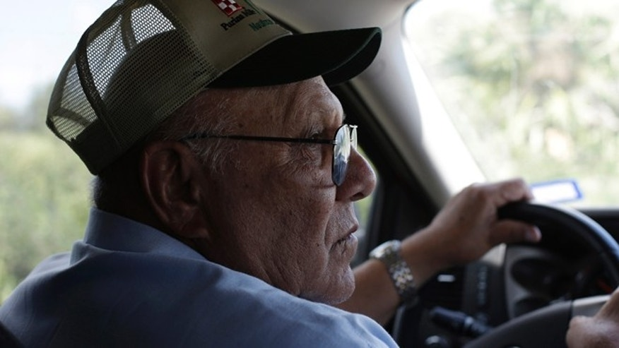 In this Sept. 6, 2012, photo, cotton farmer Teofilo âJuniorâ Flores drives his truck through his property in Brownsville, Texas. Since 2008, hundreds of landowners on the U.S.-Mexico border have sought fair prices for property that was condemned to make way for the fence, but many of them received initial offers that were far below market value. (AP Photo/Eric Gay)