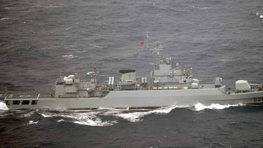 In this photo released by Japan's Joint Staff Office, a Chinese frigate sails in waters off the island of Yonaguni in Japan's Okinawa prefecture on Tuesday, Oct. 16, 2012. Japanese aircraft spotted seven Chinese warships in waters off the southern Japan island and about 200 kilometers (125 miles) from the uninhabited isles at the center of a territorial dispute between the two countries. (AP Photo/Joint Staff Office)