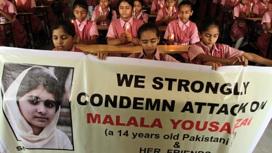 Oct. 17, 2012: Indian students participate in a prayer ceremony in support of and for the recovery of 14-year-old schoolgirl Malala Yousufzai, who was shot in the head last Tuesday by the Taliban for speaking out in support of education for women, at a school in Ahmadabad, India.