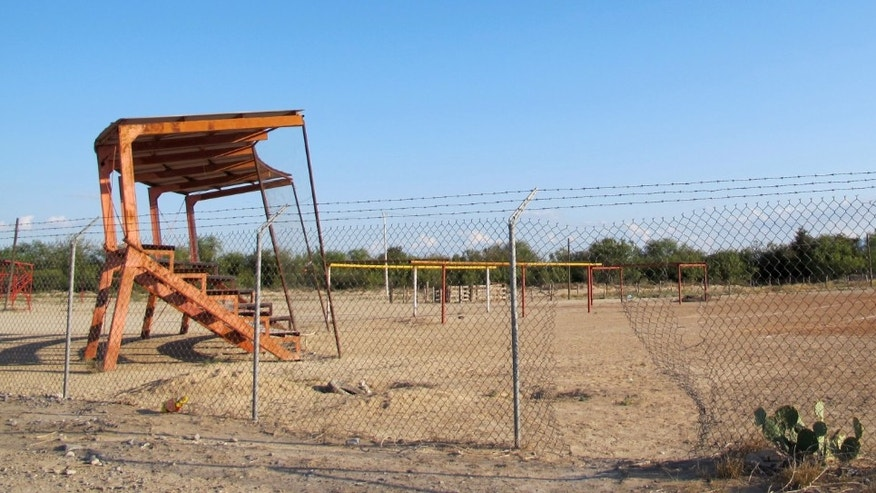 This Oct. 10, 2012 photo shows a ball field, the alleged site where Heriberto Lazcano, a founder and top leader of the Zetas drug cartel, was killed in Mexico's Coahuila state. Despite the crowd, nobody is willing to admit they were there the afternoon of Oct. 7 or saw the shootout just outside the ball field in the heart of Coahuila state, the alleged site where Mexican marines  gunned down Lazcano,  the biggest kingpin netted so far in Mexico's President Felipe Calderonâs six-year assault on organized crime. (AP Photo/Olga R. Rodriguez)