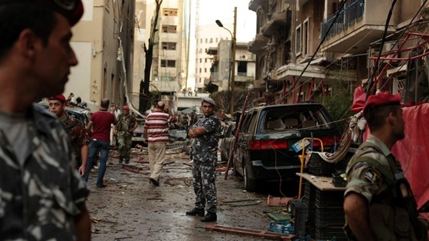 Oct. 19, 2012: Lebanese security forces gather at the site of a car bomb attack in the in the mostly Christian neighborhood of Achrafiyeh, Beirut, Lebanon.