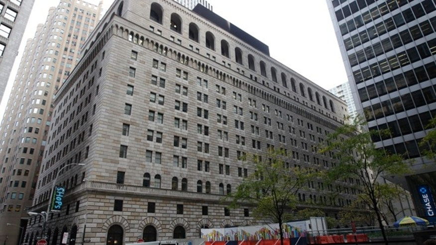 Oct. 17, 2012: Pedestrians pass the Federal Reserve Building in New York.