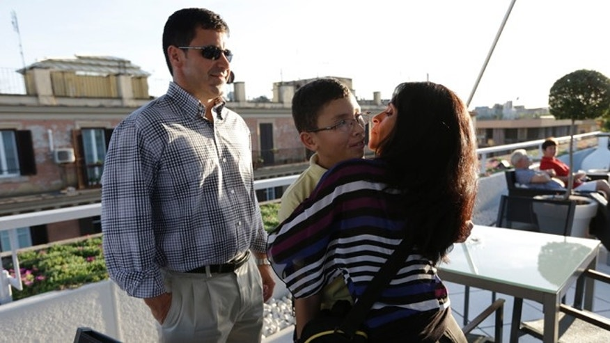 Oct. 18, 2012: Jake Finkbonner, of Ferndale, Washington, center, is hugged by his mother  Elsa, as his father Donny looks at them, in Rome.