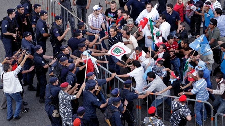 Oct. 21, 2012: Police and protesters clash after the funeral of Brig. Gen. Wissam al-Hassan in Beirut, Lebanon.
