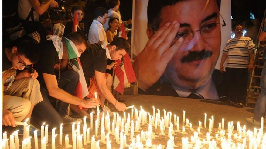 Oct. 20, 2012: Lebanese mourners light candles during a vigil for Brig. Gen. Wissam al-Hassan and at least seven others who were killed in a Friday bomb attack in Beirut.