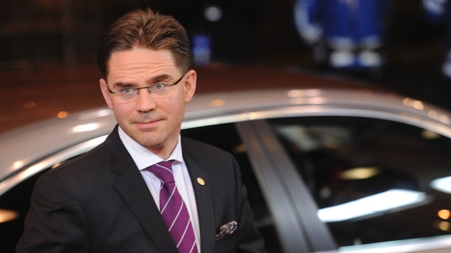 FILE - In this Dec. 8, 2011 file photo, Finland's Prime Minister Jyrki Tapani Katainen arrives for an EU summit in Brussels. A government spokesman said Monday, Oct. 22, 2012 that security guards stopped a knife-wielding man from stabbing Katainen while he was campaigning for municipal elections. (AP Photo/Geert Vanden Wijngaert, File)