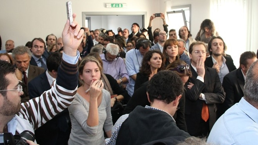 Oct. 22, 2012: People listen to the verdict at L'Aquila court, Italy.