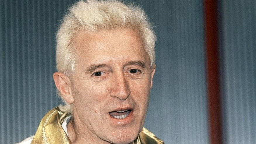 British disc jockey and BBC TV presenter Jimmy Savile shown here in 1986, died last year. (AP)
