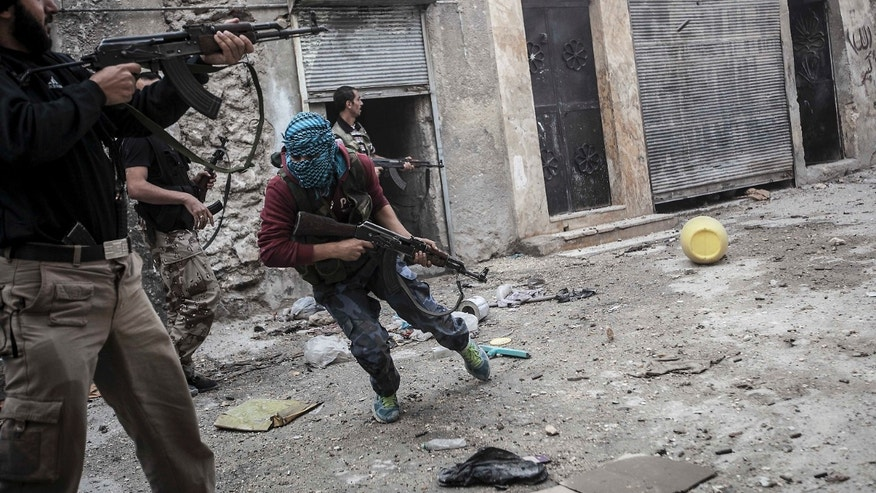 Oct. 24, 2012 - rebel fighters retreat as enemy fire targets rebel position during clashes at the Moaskar front line, a battlefield in Aleppo, Syria.