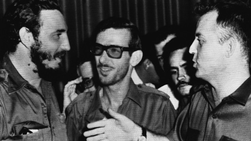FILE - In this Aug. 14, 1959 file photo, Cuban leader Fidel Castro, left, smiles as he confers with aides Maj. Eloy Gutierrez-Menoyo, center, and Maj. William A. Morgan, right, in Havana, Cuba on Aug. 14, 1959. Gutierrez-Menoyo, who went from rebel commander fighting alongside Fidel Castro to a foe launching commando raids against the island before settling inside Cuba as a moderate, pro-dialogue dissident, died early Friday. He was 77.  (AP Photo, File)