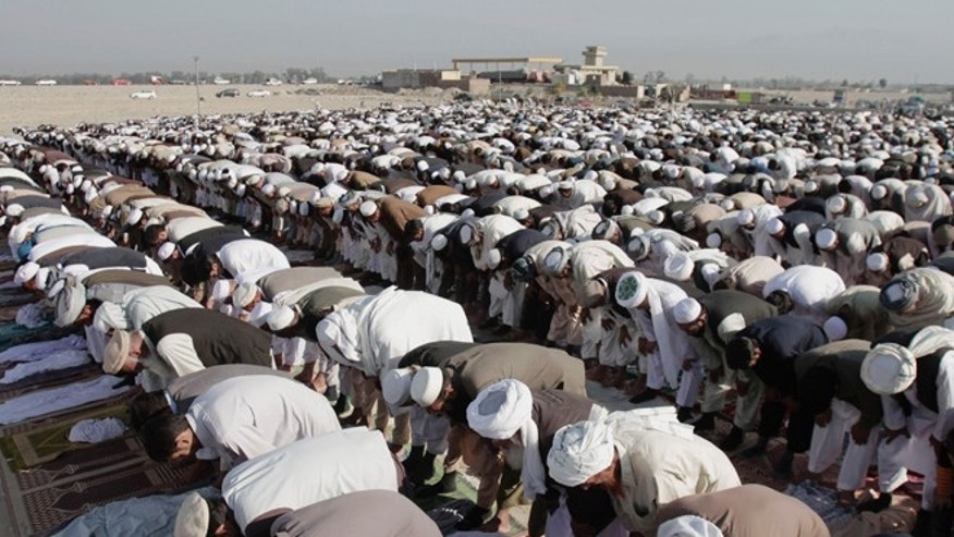 Oct. 26, 2012: Afghans offer Eid al-Adha prayers outside a mosque in the outskirt of Jalalabad east of Kabul, Afghanistan.