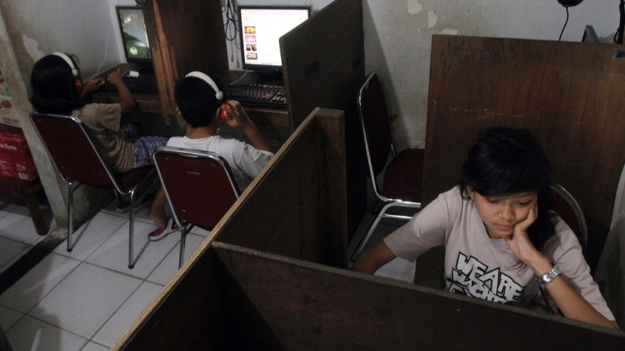 Oct. 19, 2012: Indonesian youths browse at an internet cafe in Jakarta, Indonesia.