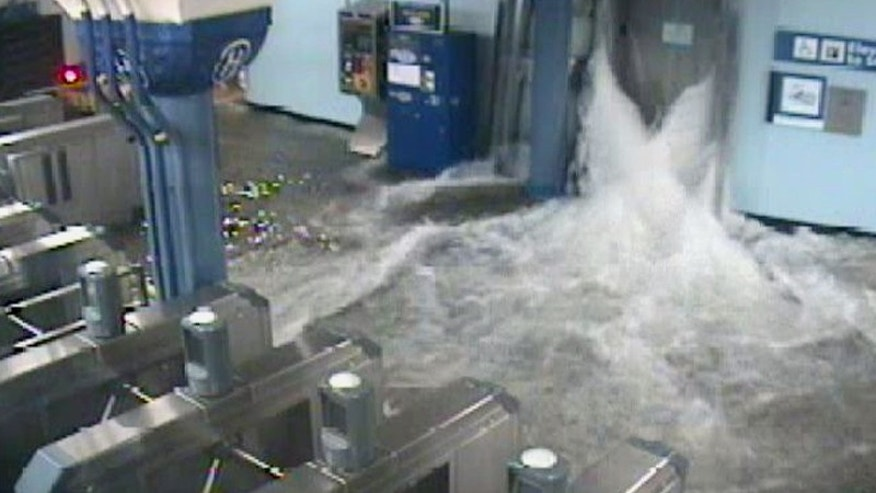 In this photo provided by the Port Authority of New York and New Jersey a surveillance camera captures the PATH station in Hoboken, N.J., as it is flooded shortly before 9:30 p.m. EDT on Monday, Oct. 29, 2012. Sandy continued on its path Monday, as the storm forced the shutdown of mass transit, schools and financial markets, sending coastal residents fleeing, and threatening a dangerous mix of high winds and soaking rain. (AP Photo/Port Authority of New York and New Jersey)