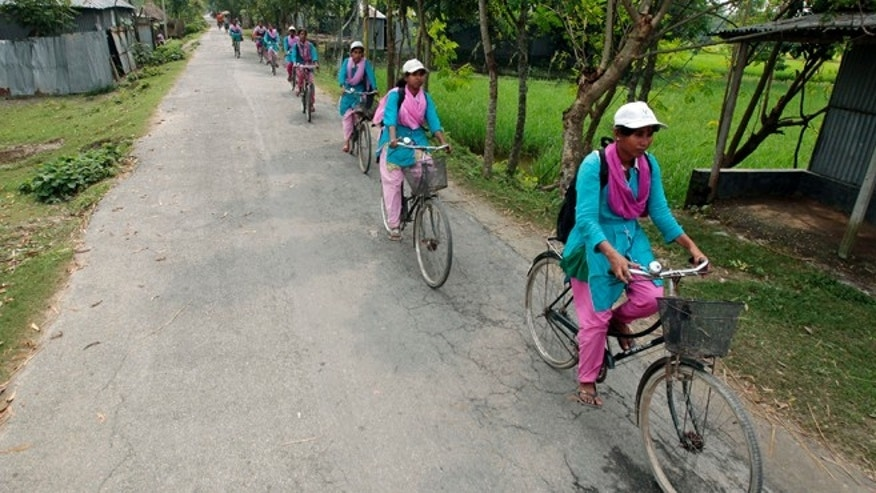 "Sept. 30, 2012:""Info Ladies"" pedal their way to Saghata, a remote impoverished farming village in Bangladesh."