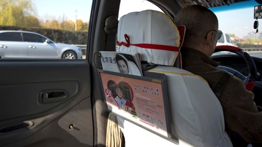 Nov. 1, 2012: A window handle on the door at the back seat is seen removed in a taxi in Beijing. Not only have taxi drivers removed the window handles from their doors, but their passengers must sign agreements promising to keep their windows and doors locked.
