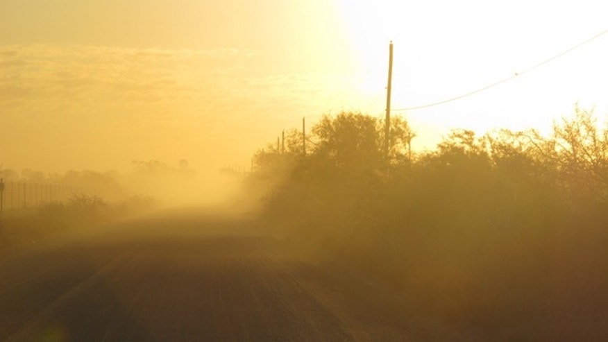 Oct. 26, 2012: The sun rises along the stretch of gravel road near La Joya, Texas, where a Texas Department of Public Safety helicopter and sharpshooter assisted the previous day in the chase of a suspected undocumented immigrant smuggler.
