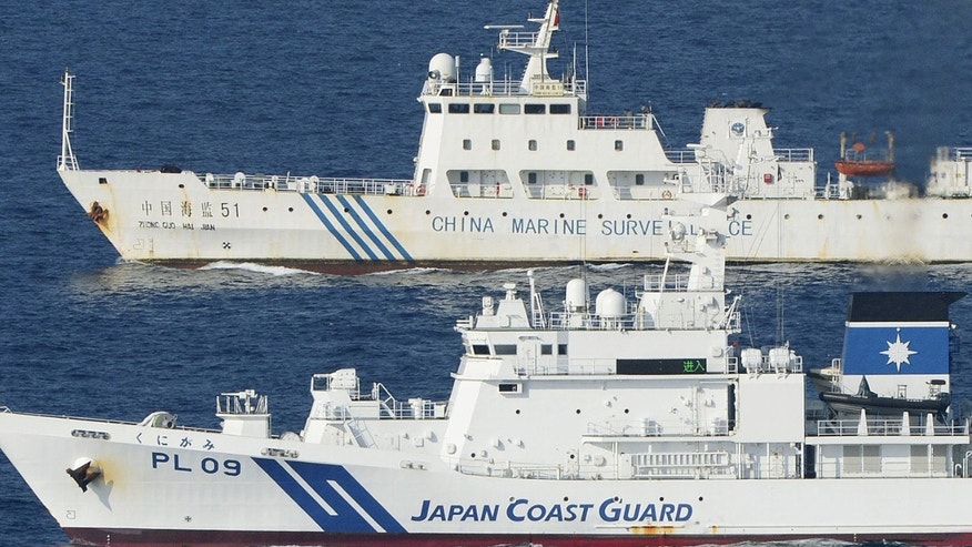 Oct. 25, 2012: Ships of China Marine Surveillance and Japan Coast Guard steam side by side near disputed islands, called Senkaku in Japan and Diaoyu in China, in the East China Sea.