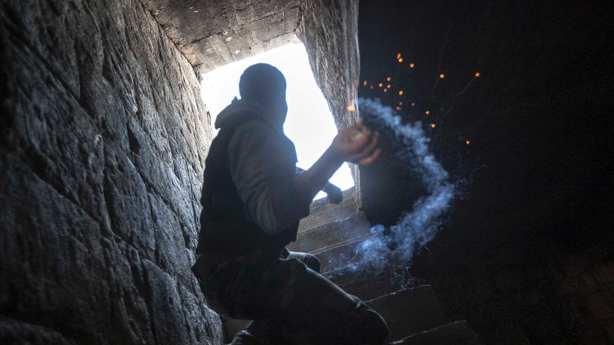 Nov. 04, 2012: A rebel fighter prepares to throw a homemade grenade toward Syrian troops loyal to President Bashar Assad who are hiding in a nearby building as they attempt to gain ground against rebel lines during heavy clashes in the Jedida district of Aleppo, Syria.