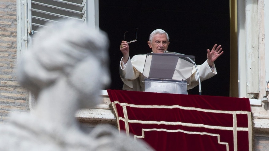 Nov. 1, 2012: Pope Benedict XVI waves to faithful during the Angelus noon prayer he delivered from the window of his studio overlooking St. Peter's square at the Vatican, on the occasion of All Saints day.