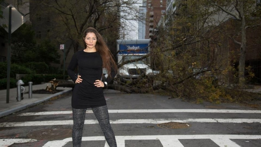 Nana Gouvêa poses after Superstorm Sandy hits New York City.