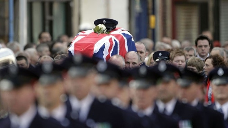 Nov. 6, 2012: Prison Officers carry the coffin of their murdered colleague David Black to Molesworth Presbyterian Church in Cookstown, Northern Ireland.