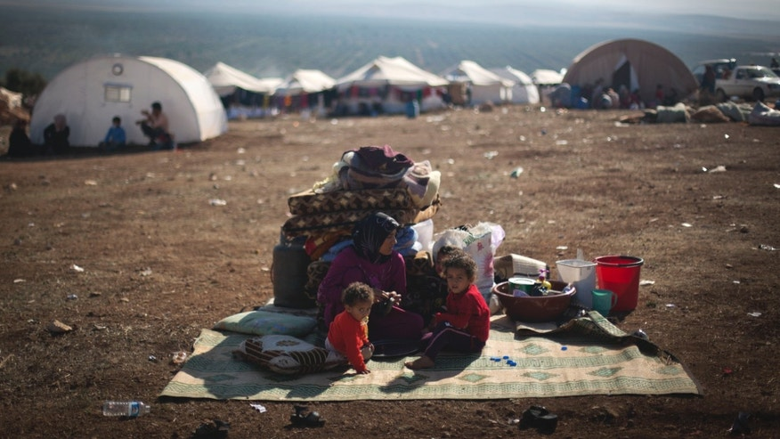 Nov. 7, 2012 - Syrian family who fled from the violence in their village, at a displaced camp, in the Syrian village of Atma.