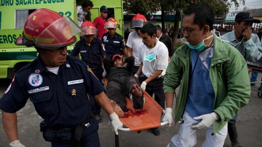 Nov. 7, 2012: Firefighters transport a wounded resident into a public hospital after he was injured in a magnitude 7.4 earthquake that struck in San Marcos, Guatemala.
