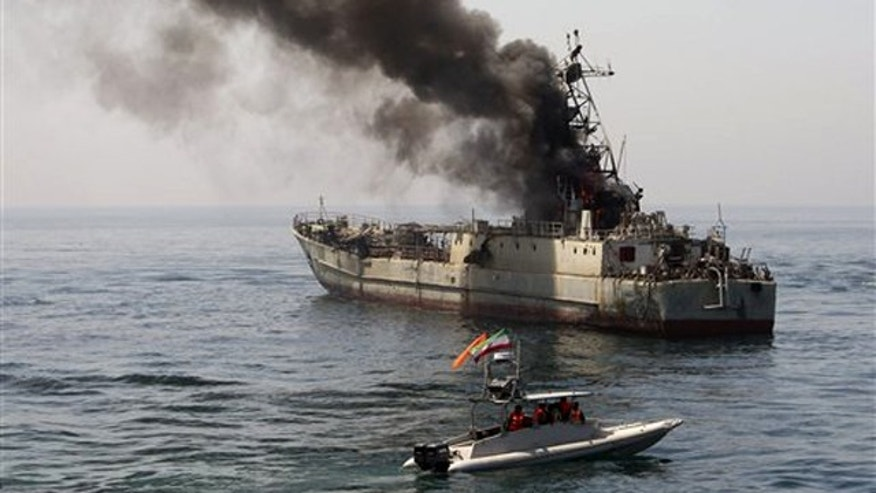 In this photo released by the semi-official Iranian Fars News Agency, an abandoned war ship, being used as a target, is burning during Revolutionary Guard's maneuver in the Persian Gulf, Iran, Thursday, April 22, 2010. Iran's elite Revolutionary Guard on Thursday started large-scale war games in the Persian Gulf and the strategic Strait of Hormuz, state television reported. Iran has been holding military maneuvers in the gulf and the Strait of Hormuz annually since 2006 to show off its military capabilities.
